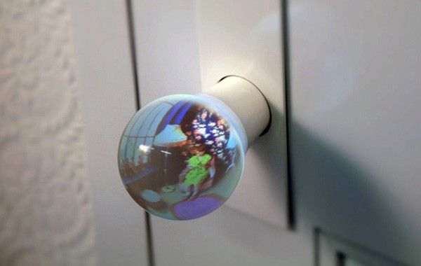 Fisheyed Glass Globe Doorknobs - the globe on your end of the door provides a wide-angle view of what's on the other side, which is achieved by collecting and reflecting light soaked up by another globe on the other end. I'd consider using this at my front and back door.