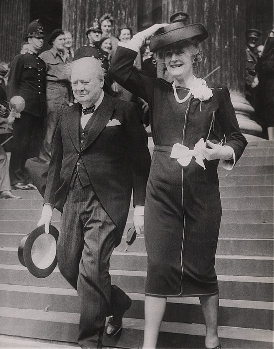 Prime Minister Winston Churchill and Mrs. Churchill leave St. Paul's Cathedral in London after a Thanksgiving service at the end of World War II in Europe. May 13, 1945.