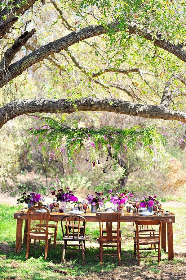 reception under the trees, photo by Arina B Photography http://ruffledblog.com/purple-inspired-wedding-ideas #weddingreception #tablescapes