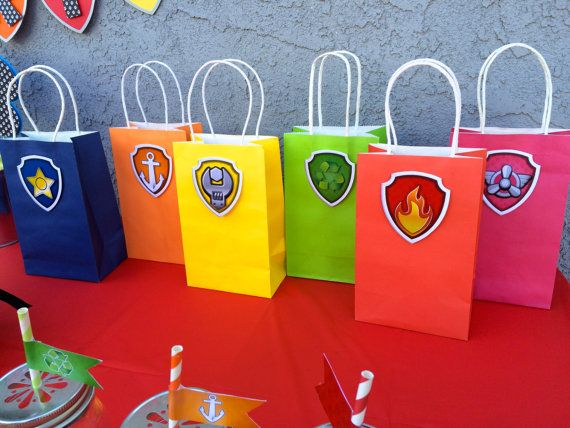 Paw Patrol Is On A Roll And Now FEATURING EVEREST This Listing Includes 7 Colored Favor Bags With Handle Each Bag Badge