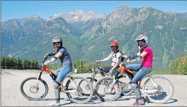 """Let it ride on B.C. ski hill"" article on Panorama Mountain Village Downhill Mountain Biking by Debbie Olsen for the Calgary Herald. Photo credit, Greg Olsen."