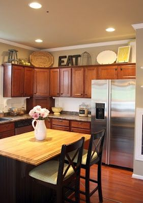 TONS of above kitchen cabinet decorating ideas! Now I just need a house... I like the butcher block for island