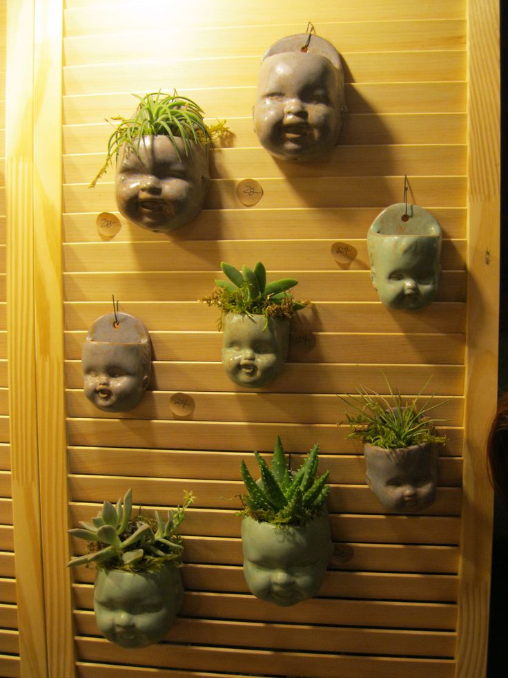 I love these clay doll head planters from the Dallas Etsy Spring Bash.