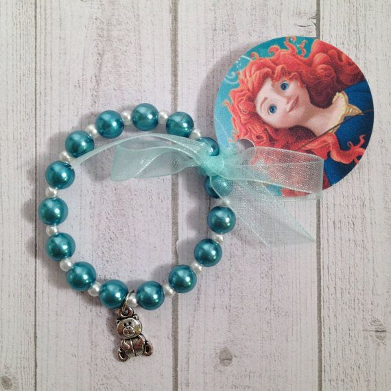 Merida from Brave Bear charm bracelet. It is a 6 inch bracelet on stretchy cord with round turquois pearl like beads and a bear like her