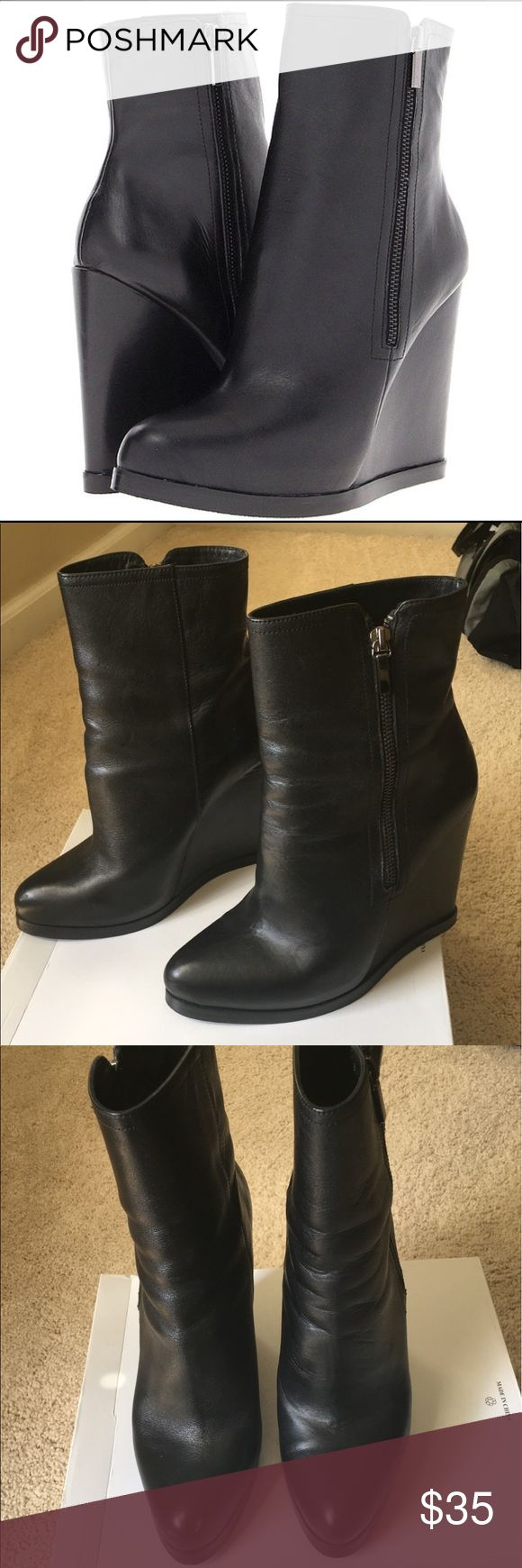 Truth or Dare by Madonna Sterlin Leather Boots Edgy & comfy black wedge boots. In very good condition, only a few marks in the back heel of the left boot (see pic). I love how these look with black skinny jeans and large flare jeans. Truth or Dare by Madonna Shoes Ankle Boots & Booties