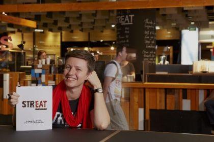 STREAT cofounder Rebecca Scott with the STREAT cookbook