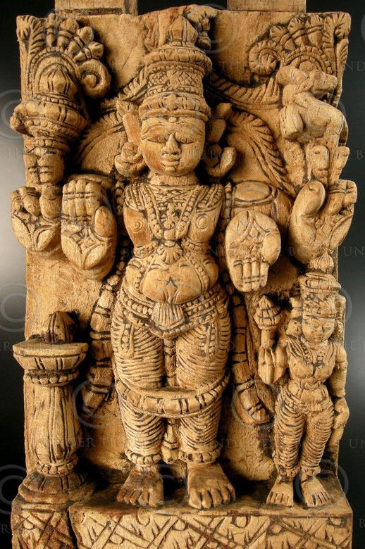 Shiva carved panel 08LN13D Sculpture depicting Shiva as Chandrashekara standing with consort Parvati. Carved in hard and heavy wood on a temple chariot panel, one of eight panels of the same chariot (see other 08LN13). Tamil Nadu, southern India. 18-19th century.