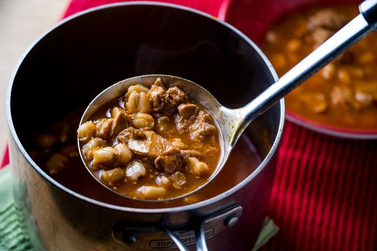 Menudo is a chili pepper broth soup made with cow stomach and hominy (dried maize kernels).