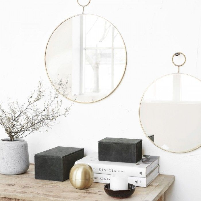 Brass Loop Mirror - If you've been going round in circles trying to find the perfect wall mirror, complete your loop with one of these well consideredbrass framed examples that playfully incorporate their hook into a distinctive double circleddesign