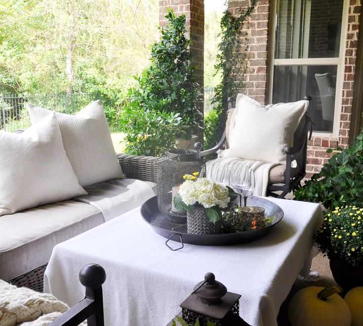 beautiful-outdoor-living-area-decorated-for-fall-with-cream-and-white