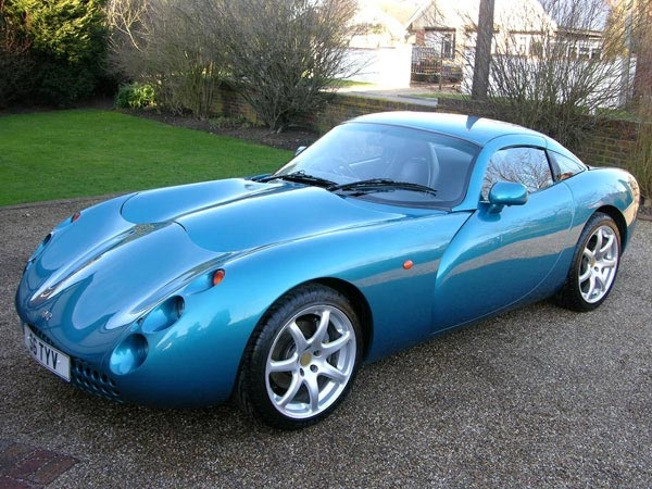 67. TVR Tuscan (1999–2006)  With its spidery eyes, classic British shape, and roaring Speed Six engine, the modern iteration of the TVR Tuscan is like nothing else on the road.