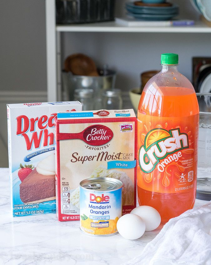 This Orange Crush Cake is a super simple dessert recipe that is infused with Orange Crush Soda! Perfect for pot lucks and kids!