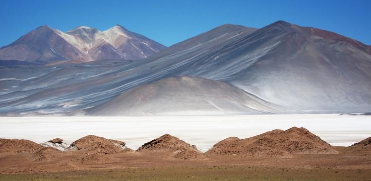 Salt Flat 'Salta Aguas Calientes' and mountain 'Cerro Tridentes' in Atacama, Chile.