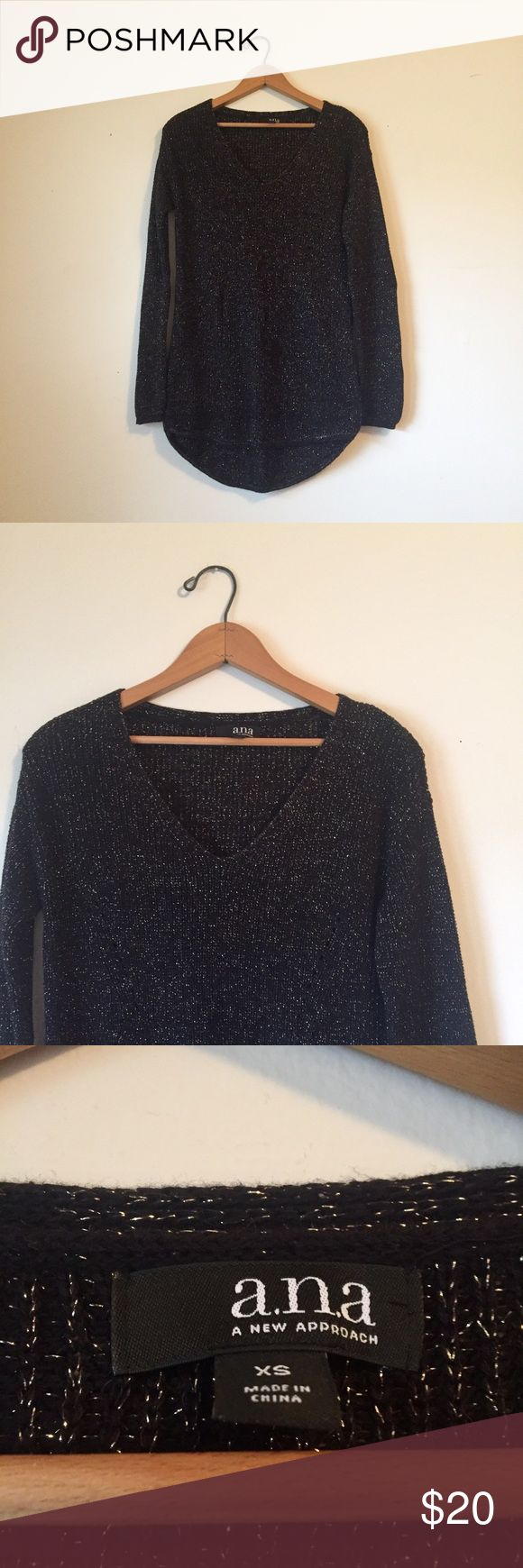 Black & silver hi low tunic sweater Beautiful a.n.a black and silver sparkle high low  tunic sweater. In excellent condition, worn once. Perfect for work or the weekend, can be dressed up or down. Pair with black leggings or  distressed skinny jeans, a long necklace and leather booties. a.n.a Sweaters V-Necks