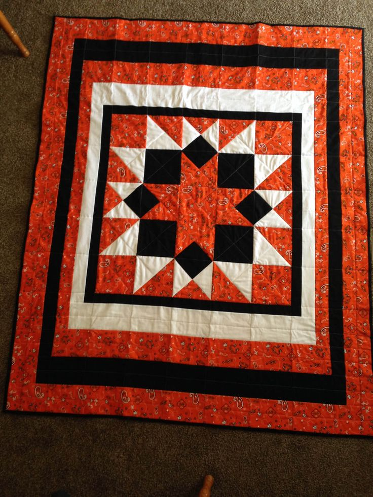 Quilted Throw with Oklahoma State University (OSU) Fabric by patchworkcreations51 on Etsy https://www.etsy.com/listing/504017306/quilted-throw-with-oklahoma-state