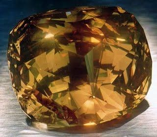 """The Golden Jubilee is the largest faceted diamond in the world, weighing 545.67 carats. Cutter Gabi Tolkowsky describes the cut as a """"fire rose cushion cut."""" The color has been graded as fancy yellow-brown."""