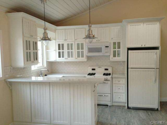 Country Kitchen With Undermount Sink, U Shaped, American Woodmark  Shorebrook Painted Linen Cabinets