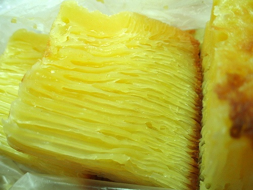 """Bika Ambon is a kind of confectionary from Indonesia. Made from ingredients such as eggs, sugar, and coconut milk, bika ambon generally sold with pandan flavor, although it is now also available other flavors such as durian, cheese, and chocolate. Bika Ambon origin is not clearly known. Although the name contains the word """"Ambon"""", bika ambon exactly known as a typical souvenirs of the city of Medan, North Sumatra. Bika ambon do not have to ask again in the sweet, delicious."""