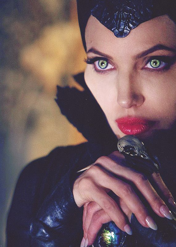 Angelina Jolie looks absolutely gorgeous. She fits Maleficent well.