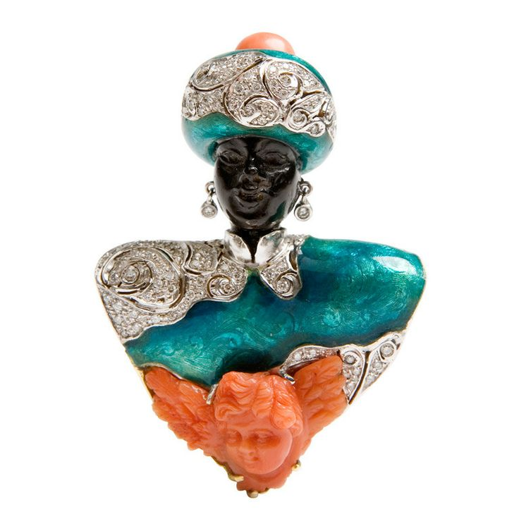 NARDI Venice circa 1970, Blackamoor pin in ebony, yellow and white gold enameled in blue, set with an angel sculpted coral of the XIXth century, diamonds