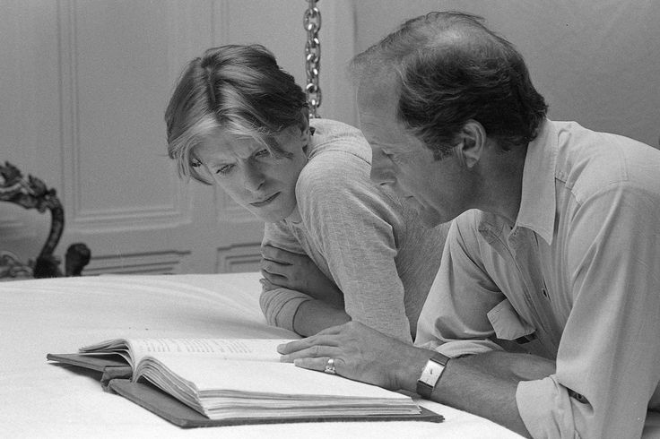 """David Bowie and Nicolas Roeg going over the script for The Man Who Fell To Earth, 1975"