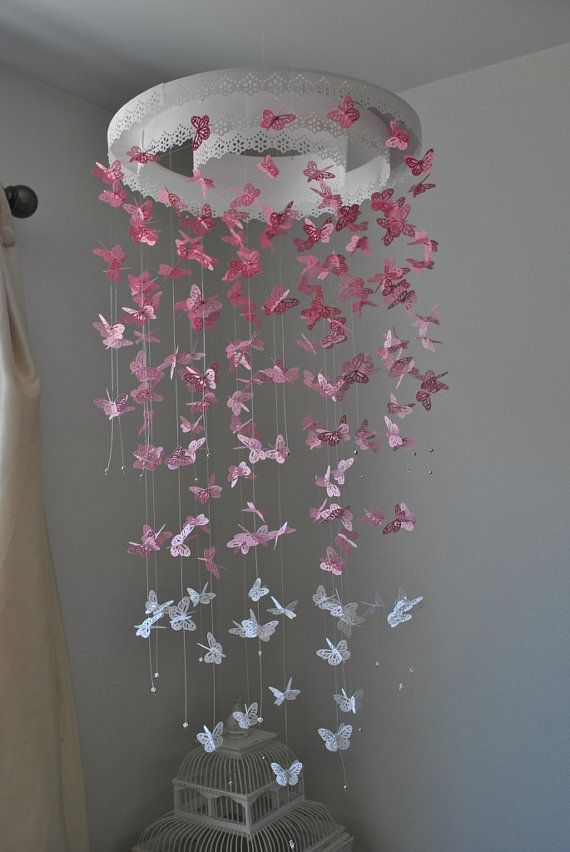 Butterfly mobile chandelier! I never wanted butterflies in her nursery but sine she loved them so much at the museum,  we decided to have her one made to match the pink on her wall..
