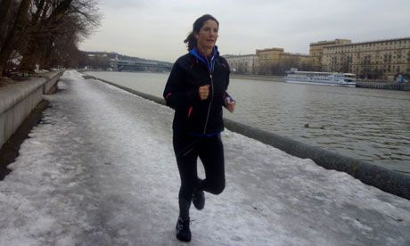 Lucy Ward runs on the banks of the Moskva river, Moscow. Photograph: Christina Marshall for the Observer
