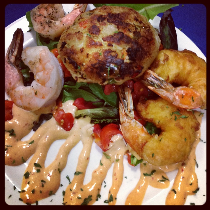 Seaport Grille Combo Appetizer - Crab Cake, Two Grilled Shrimp - Two Tempura Shrimp served with spicy chipotle remoulade and dressed spring greens. You will LOVE this ONE!!