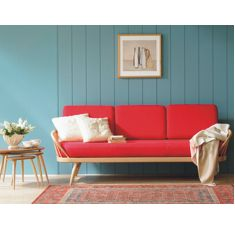 Ah, my great grandmother's studio couch.  How good you'll look reuphostered in red.  Wish I had the pebble tables too.