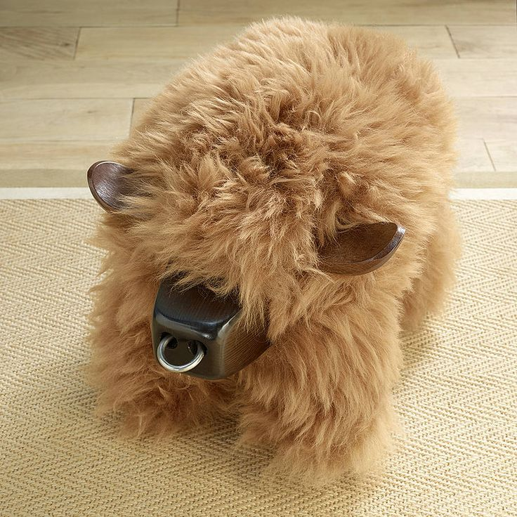 Highland Cow Shaped Sheepskin Footstool By The Wool Room