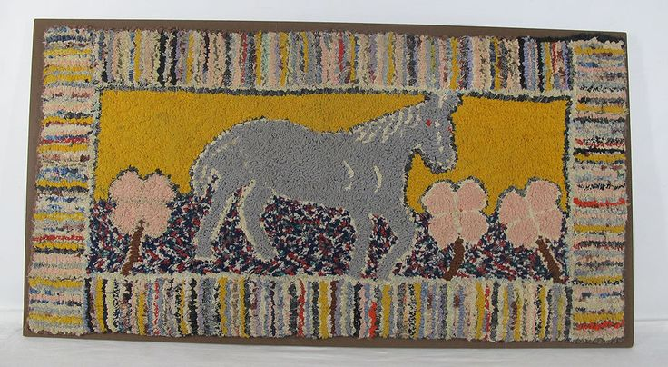In this auction we have an original antique American hooked rug depicting a grey horse with red eyes walking through a field of pink clover, dating to the late 1800's, early 1900's. Framed in a rainbow of color, the sky filling the background is a mustard yellow while the ground is shades of blue, red, green and white. Mounted, though we will remove it from the board to save the winning bidder on shipping, it measures approx. 19'' x 37''. There is expected age wear, ...