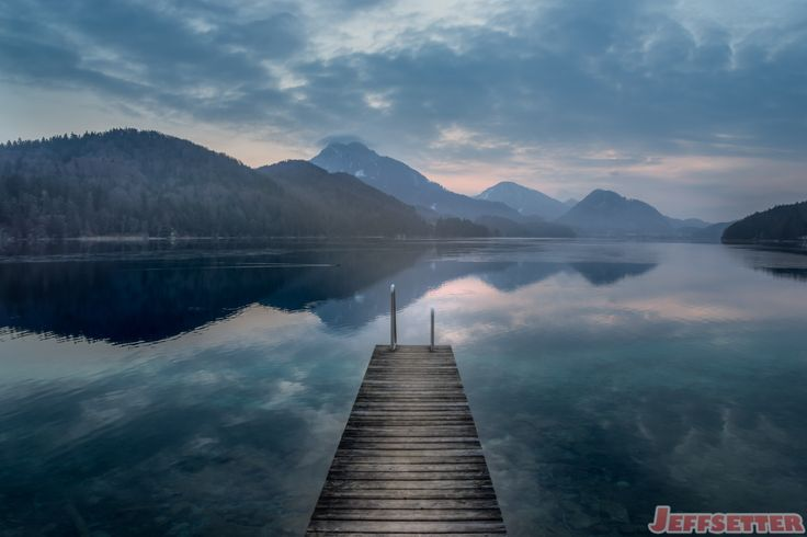 The cool tones of winter on Lake Fuschl in Austria provides a cool blue color…