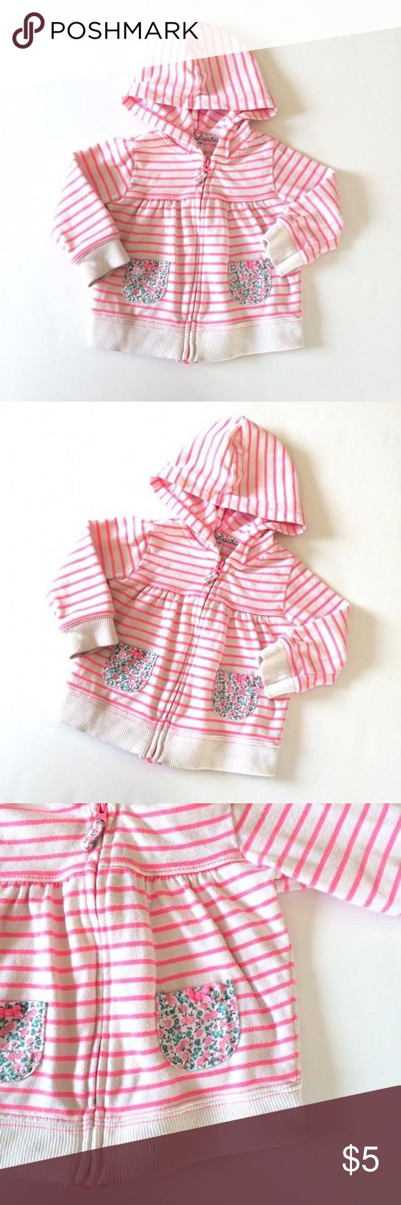 Carters Pink Striped Zip Up Hoodie This pink striped hooded sweatshirt from Carters zips up on the front and has little floral pocket details. Medium weight. Brightly colored and in excellent condition! *109, bin 2* Carters Shirts & Tops Sweatshirts & Hoodies
