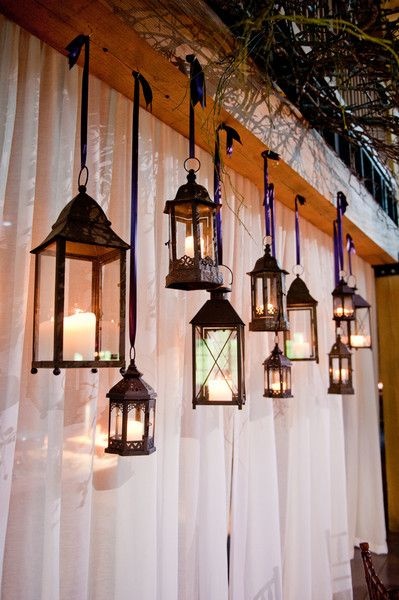 These hanging lanterns are such a unique and stunning touch! The perfect mixture of rustic and vintage. {Rae Marshall Wedding Photography}