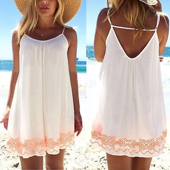 """White Boho Beach Slip/Cover Up This adorable white Boho beach slip/cover up works great over a swimsuit on a hot summer day at the beach.  Measurements: Bust-37"""", Length-30.7"""". NWOT Dresses Mini"""