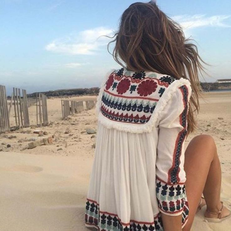 Absolutely stunning! A gorgeous white base pairs with intricate boho embroidery on this expertly constructed jacket. Designed with 3/4 sleeves, tassel tie front, embroidery & fringe throughout, and a