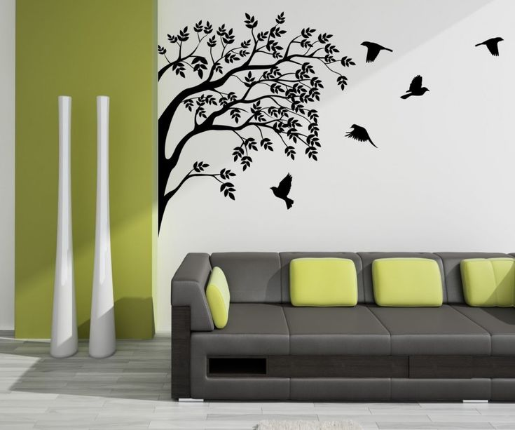 magnificent colibri bird wall art design and sakura tree in black painting with white background and black soft chair and luxury gray tile for minimalist - Artistic Wall Design