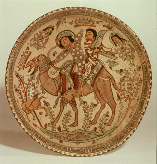 A Saljuq Mināʾi bowl showing Bahrām Gur and Āzāde the Harpist, late 12th-early 13th centuries.