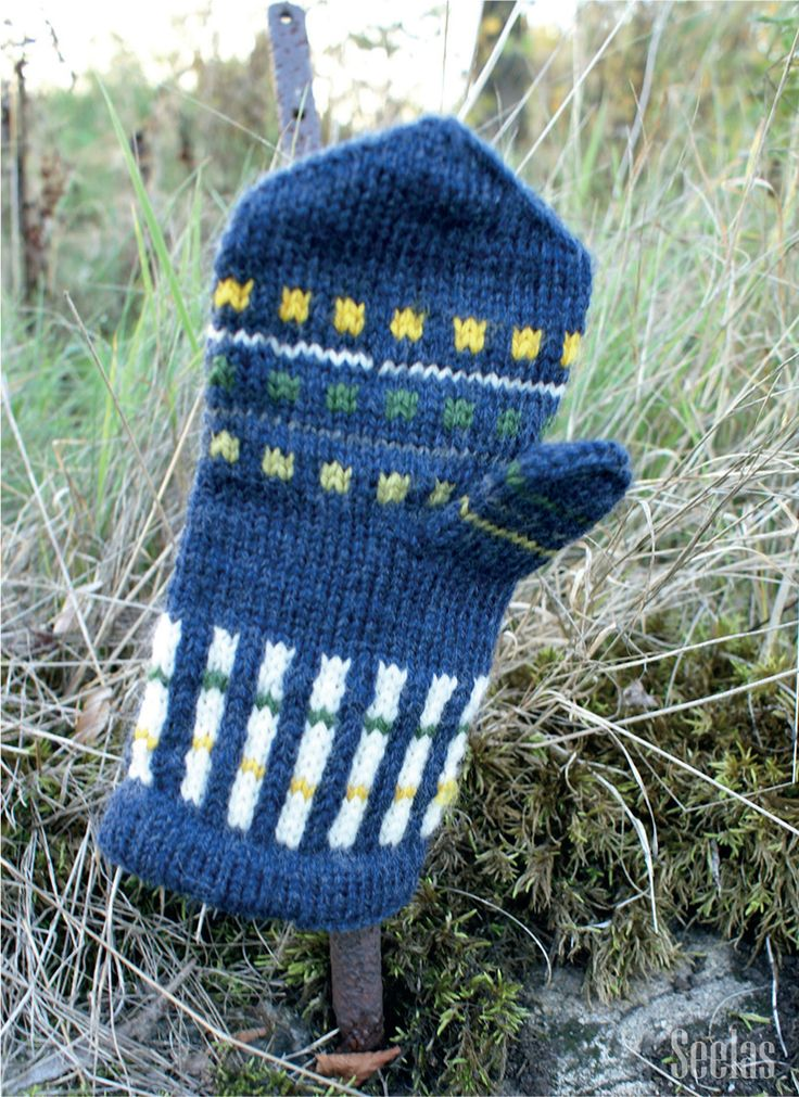 The mitten of Järvenpää, 'Keltavuokko' (in English 'Yellow Anemone'). Design by Eva Roos-Rautakorpi. Instructions for patters in Finnish can be purchased at Cafe Lentävä Lapanen (www.lentavalapane...), Järvenpää, Finland