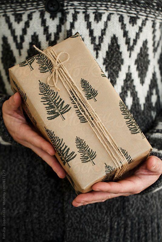Man holding Christmas gift by Dobránska Renáta