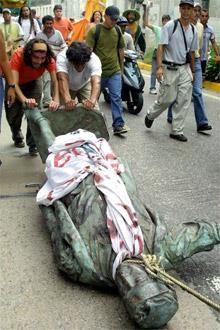 """A statue of Christopher Columbus was pulled down by protesters in Caracas, Venezuela, in 2004. The former """"Columbus Day"""" is now marked as Indigenous Resistance Day."""