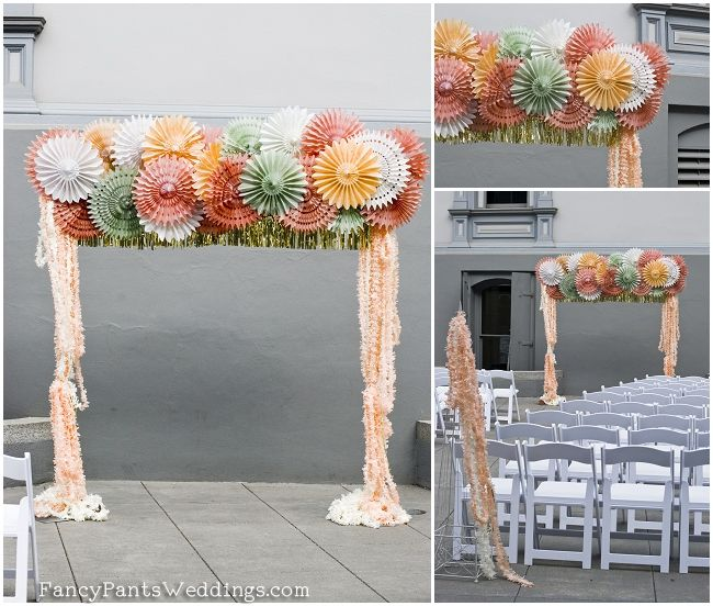 DIY tissue paper pinwheel ceremony arch www.fancypantsweddings.com  http://www.fancypantsweddings.com/diy-tissue-paper-fan-wedding-arch/