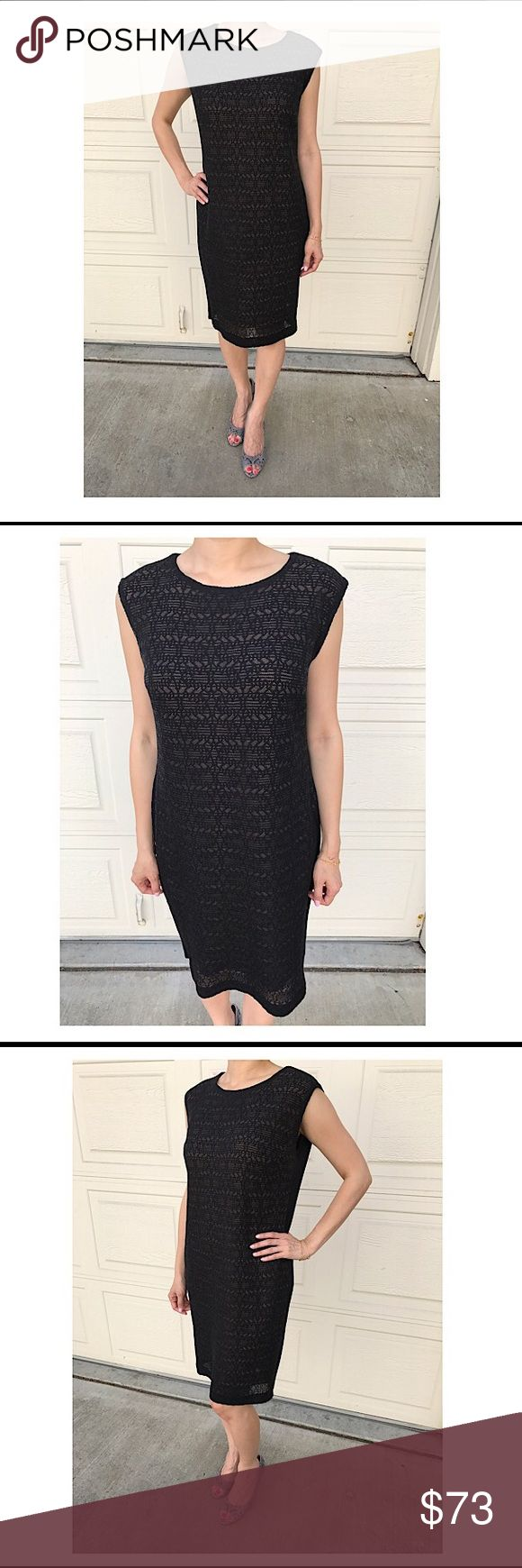 MISOOK Niemen Marcus 👚lace shell black dress LBD MISOOK (Niemen Marcus brand) black lace shell pattern on front with nude lining and plain black back. Made in Korea. Pull on style, no zippers, loose fit, marked size S, but feels like M. Small snag near the knee area as shown in last photo, not noticeable. COLE HAAN snakeskin pumps and FENDI B bag are for sale too in my closet. Open to reasonable offers or bundle 2 for 15% off! Misook Dresses Midi