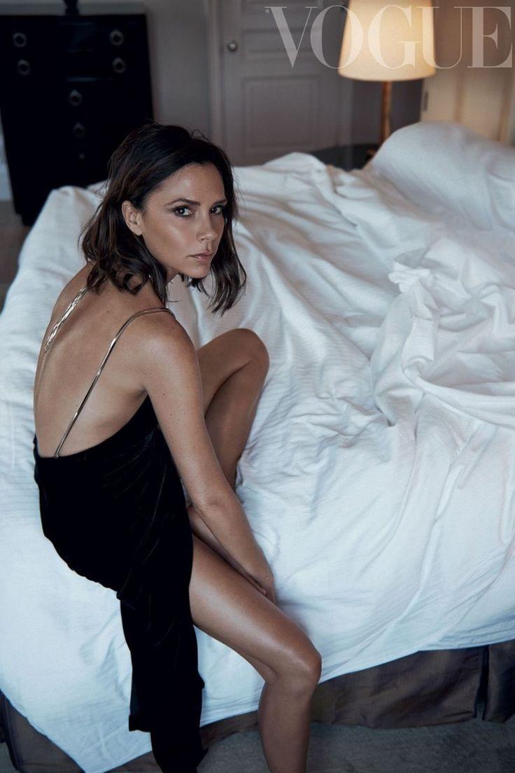 Victoria Beckham poses in bed wearing a slip dress for Vogue UK Magazine October 2016