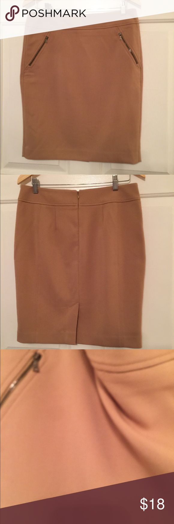 Loft Tan Pencil Skirt A must have in every closet. A tan pencil skirt with two front zippers and a zipper in the back. It's fully lined and only worn a couple of times. No stains, tears or defects. Bundle to receive an additional discount!!🤗 LOFT Skirts