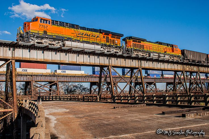 https://flic.kr/p/E9YQqG | BNSF 7757 | GE ES44DC | BNSF Frisco Bridge | A new BNSF ES44DC unit brings a unit train westbound over the Mississippi River into Arkansas on the Frisco Bridge. The Frisco was completed and opened for service in 1892. The structure supporting the bridge was replaced and updated during 2016-2017.