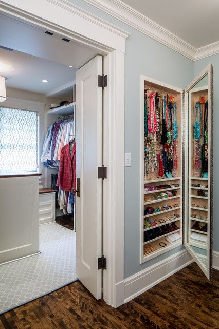 These homeowners carved out an accessory closet between the studs of an unused wall and lined it with a mirror to add high function to their dressing room. J. Korsbon Designs via houzz.com