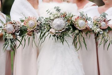 Native bridal bouquet. King protea, gum foliage, silver suede foliage, wax flower, blushing bride, gum nuts, heather, pale pink proteas,  cream hypericum berries and grevillea. By Naomi Rose Floral Design