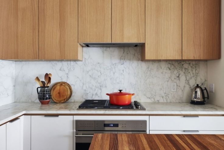 Marble counter and backsplash. Cooktop and built in oven.