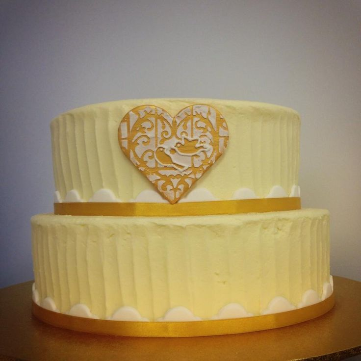 Pastel two tiered wedding cake with fondant detailing